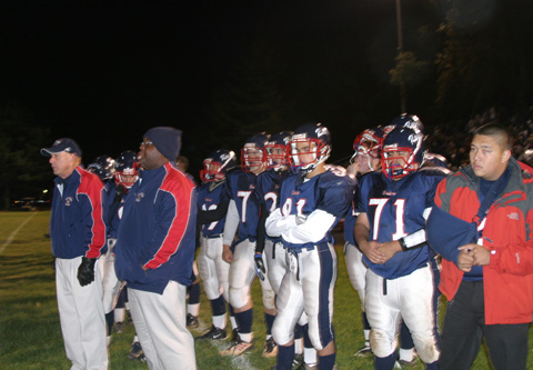 THE FORLORN SIDELINE of the J.E.B. Stuart Raiders looks on as Washington-Lee puts a damper on their homecoming. (Photo: News-Press)
