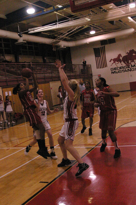 MASON'S NICOLE MITCHELL goes up for a shot against Clarke. (Photo: Bob Morrison, Bonnie Briar Productions)