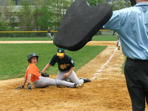 Tyler Waters slides safely under the tag during Little League action last week. (PHOTO: JANET PHILIPS)