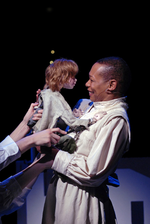 """Actress Karen Kandel as The Narrator shares a moment with Peter in Arena Stage's presentation of """"Peter & Wendy.""""  (Photo courtesy: Arena Stage)"""
