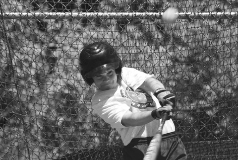 Tyler Waters of the 11-12 year-old team takes a rip in the batting cage.