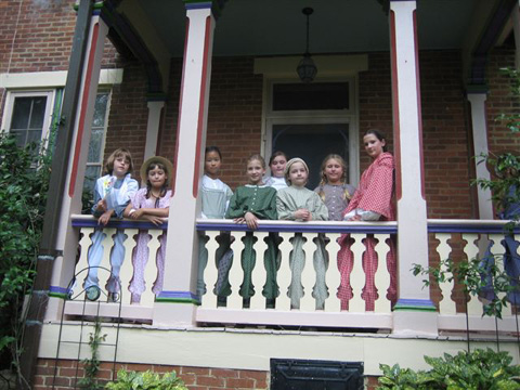 Girls gather in front of historic Mt. Hope. From left to right are: Esther Wisdom, Annie Parnell, Carrie Gudenkauf, Annie Washa, Haley Loftur-Thun, Lillian Soltys, Kerri Gannon and Emma Washa.