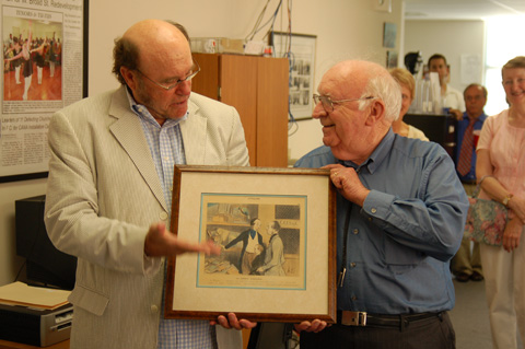 "FALLS CHURCH attorney Lee Farnum Johnson, Jr. (right), presented an original H. Daumier lithograph to Nicholas F. Benton of the Falls Church News-Press during the News-Press' ""Meet the Press"" open house last week. The lithograph had been a gift to Johnson's father, also a weekly newspaper editor. (News-Press photo)"