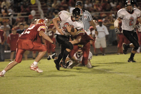 Junior Charlie Mann (No. 23) breaks a tackle. (Photo: Bob Morrison, Bonnie Briar, LLC)