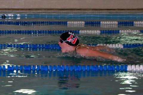 Karen Hamill competes during a recent meet for the George Mason High School girls varsity swim team. (Photo: Emilio Ramos)