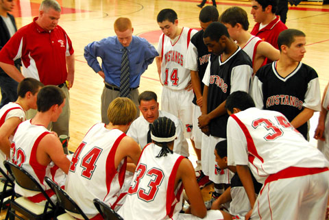 THE MUSTANGS HUDDLE around Head Coach Chris Capannola during their home victory over Clarke County last Wednesday. (Photo: Rich Johnson)