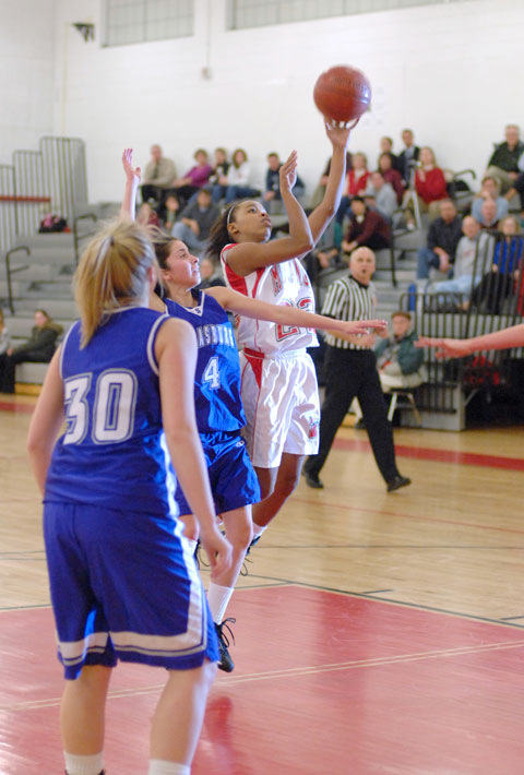 MASON'S KIM KENNY (second from left) and Nicole Mitchell (right) wait for a rebound. (Photo: News-Press)