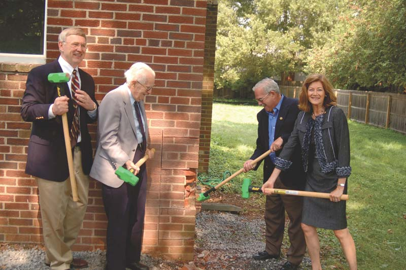 "THE WEST GROUP unveiled its project to create the mid-Atlantic region's first ""carbon neutral"" house in McLean last week. Shown here, Fairfax County Chair Gerry Connolly, Virginia Delegate Margi Vanderhye, Dranesville Supervisor John Foust and West Group Chairman Jerry Halpin begin the deconstruction of the house that will be rebuilt using 70-80% less energy than a comparable new home, and radically reduce carbon emissions through efficient design and innovative technology. (Photo: News-Press)"